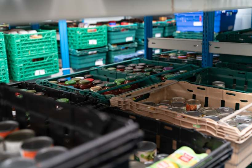 Food stacked in trays at the Colchester food bank