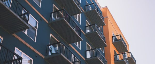 Blue and orange flats with balconies
